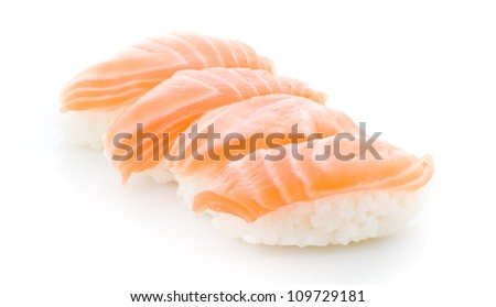Delicious salmon sushi in plate on white background