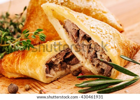 Delicious samosa pies with meat on plate. Menu, restaurant, recipe concept. Served in traditional oriental restaurant. Selected focus. - stock photo