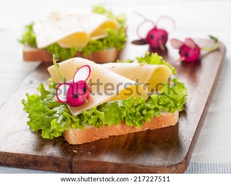 Delicious sandwich with cheese and radish like a mouse for kids party, selective focus - stock photo