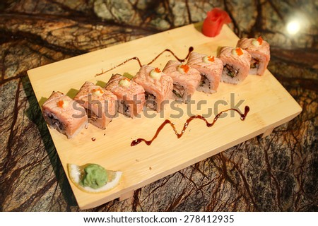 Delicious Sapporo maki sushi rolls served with a wood plate. - stock photo
