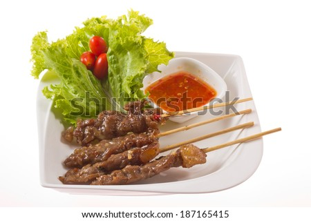 Delicious Satay beef and sauce . - stock photo