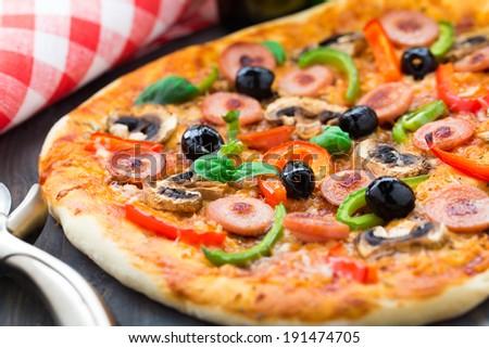 Delicious sausage pizza - stock photo