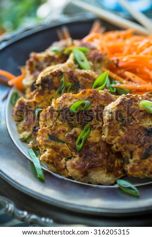 Delicious savory kimchi cakes with Asian carrot slaw - stock photo