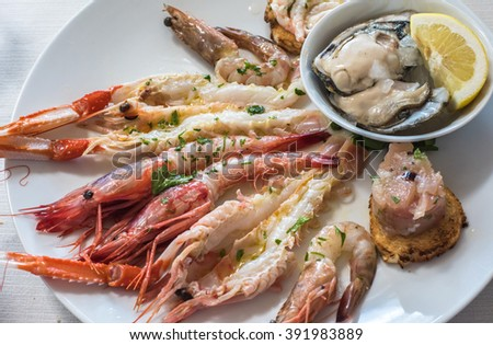 Delicious seafood carpaccio with langoustines - stock photo
