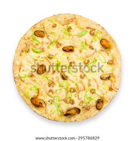 Delicious seafood pizza with shrimps, mussel, olives and leek - thin pastry crust at white background, above view - stock photo