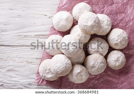 delicious shortbread polvoron closeup on a wooden table. horizontal top view