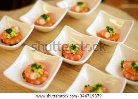 Delicious shrimp Canap���©s on plate in restaurant - stock photo