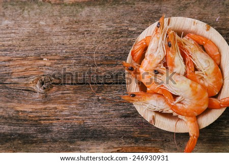 Delicious shrimps on the wooden table - stock photo