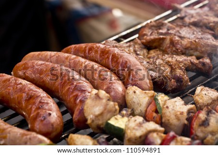 delicious sizzling meat on the barbecue - stock photo