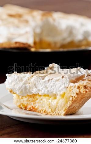 Delicious slice of classic lemon meringue pie - stock photo