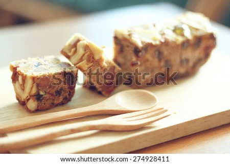 Delicious slice of Fruit and Nut Cake ,retro filter effect - stock photo