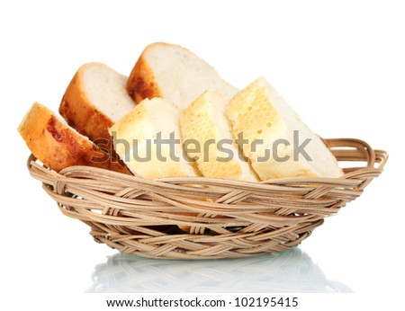 delicious sliced ? bread in wicker basket isolated on white - stock photo