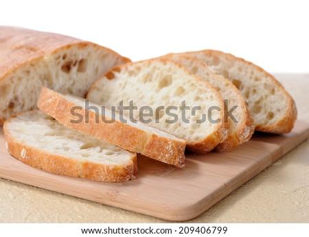 delicious sliced ciabatta bread on cutting board  - stock photo