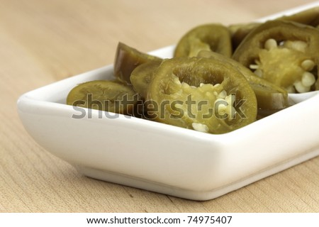 delicious sliced pickled jalapeños that will leave a hot spicy and  burnig sensation - stock photo