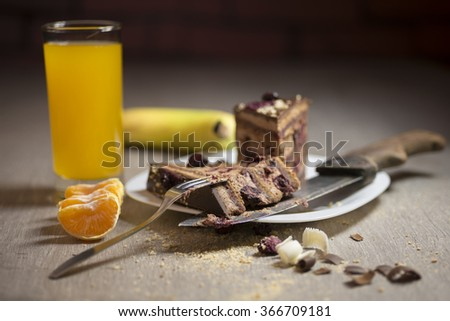 Delicious slices of cake with juice and orange fruit, shallow depth of field - stock photo