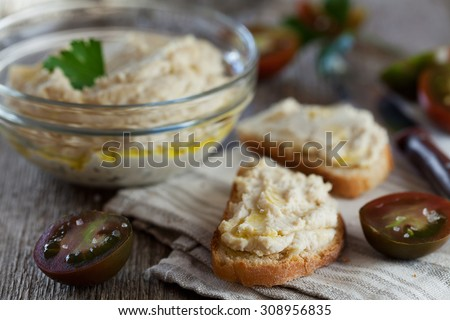 Delicious snack from crostini with chicken pate or paste and tomatoes, selective focus - stock photo
