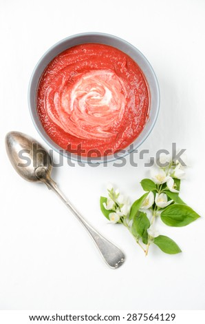 Delicious soup made of baked beetroot with cream - stock photo