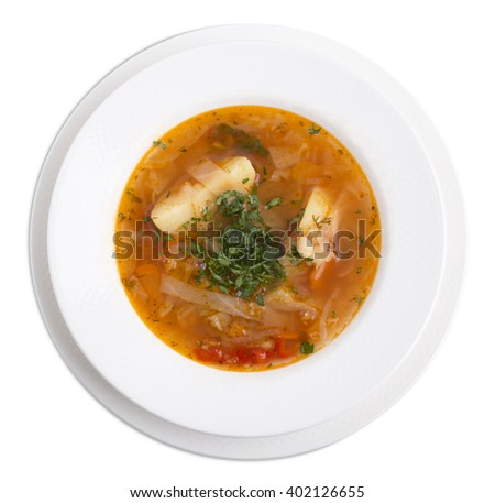 Delicious soup with vegetables and herbs. Isolated on a white background. - stock photo