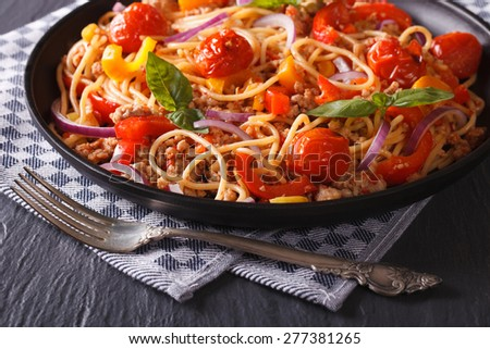 Delicious spaghetti with minced meat and vegetables close-up. horizontal  - stock photo