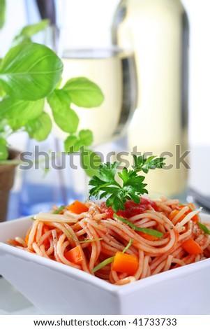 delicious spaghetti with tomato sauce, parmesan cheese and basil, narrow focus - stock photo