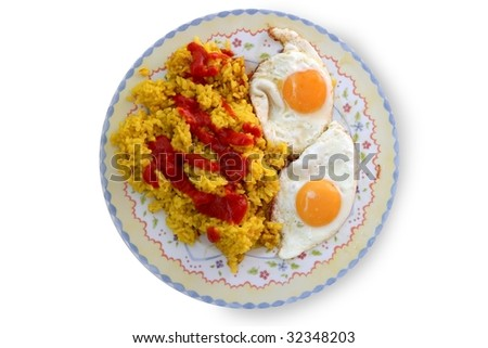 Delicious Spanish rice with tomato and two eggs on victorian dish