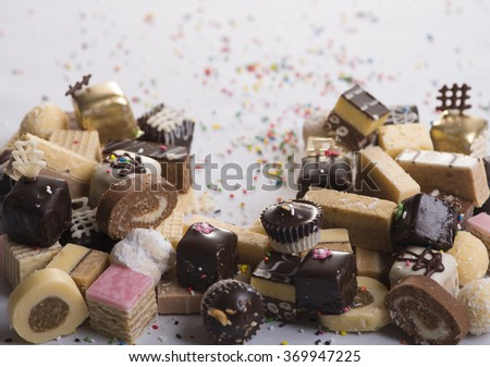 Delicious stack of several sweet cookies on table - stock photo