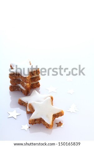 Delicious star shaped ginger biscuits for Christmas or Advent frosted in white icing with copyspace for your seasonal greeting - stock photo