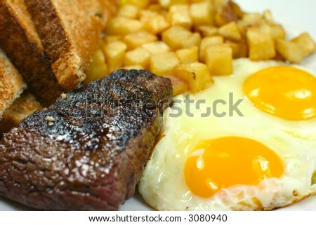Delicious steak and eggs breakfast - stock photo