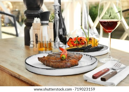 Delicious steak served with chili pepper on plate