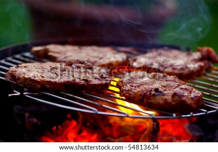 delicious steaks on the grill - stock photo