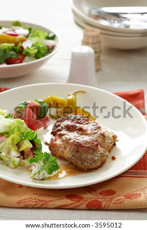 Delicious steaks with vegetable salad