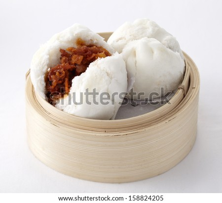 Delicious steamed buns in a bamboo steamer - stock photo