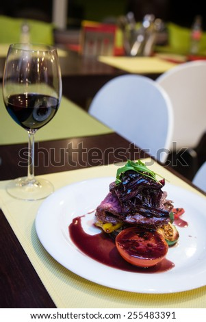 Delicious stewed steak with grilled vegetables and red onion sauce  - stock photo