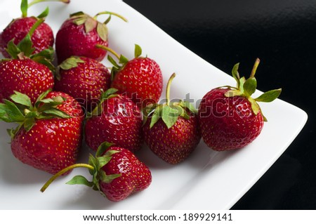 delicious strawberries on black - stock photo
