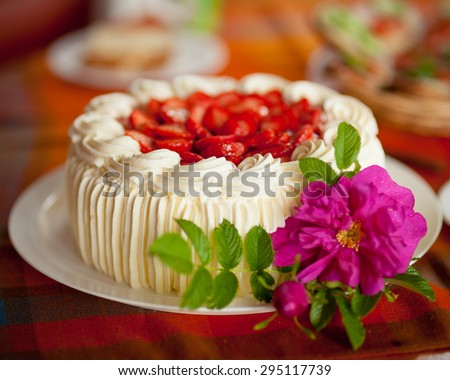 Delicious strawberry cake on coffee table - stock photo
