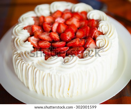 Delicious strawberry cake with strawberries and whipped cream - stock photo