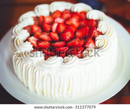 Delicious strawberry cake with whipped cream - stock photo