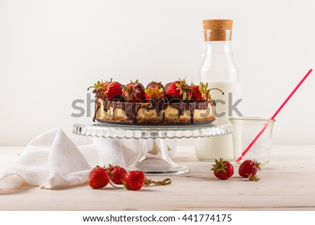 Delicious strawberry cheesecake on white wooden background. - stock photo