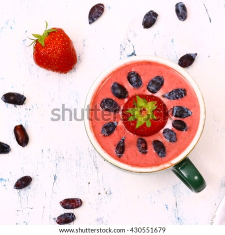 Delicious strawberry dessert with berries on the white table. - stock photo