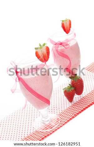 Delicious strawberry milk shake with fresh strawberries isolated on white background, vintage style. Refreshing healthy summer drink. - stock photo