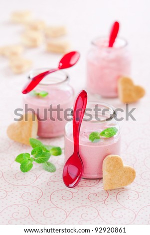Delicious strawberry, mint and yogurt soup in glass jars and shape heart cookies, selective focus - stock photo