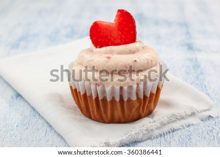 Delicious Strawberry Shortcake Cupcakes with strawberry frosting and fresh Strawberry Hearts - stock photo