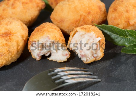 Delicious stuffed croquettes iberico ham and cheese - stock photo