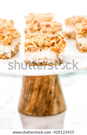 delicious summer cake with whipped cream and prepared rice with white chocolate on white wood plate on a white background. Portion of creamy No-bake. Picnic for a summer vacation with perfect cake. - stock photo