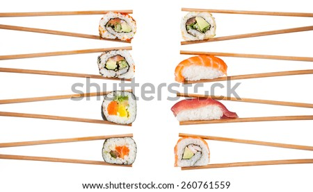 Delicious sushi, maki, nigiri pieces isolated on white background - stock photo