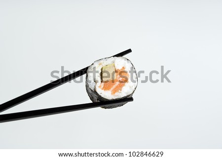 delicious sushi on a stick against a background of gray