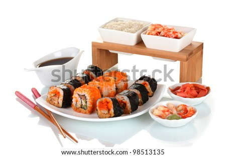 delicious sushi on plate, chopsticks, soy sauce, fish and shrimps isolated on white - stock photo