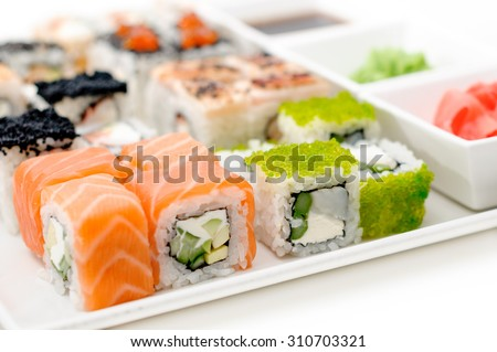 delicious sushi rolls on the plate close up - stock photo