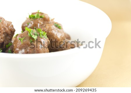 Delicious Swedish meatballs with a hearty brown sauce - stock photo
