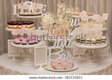 Delicious sweet buffet with cupcakes. Sweet holiday buffet with cupcakes and other desserts. Candy Bar. - stock photo